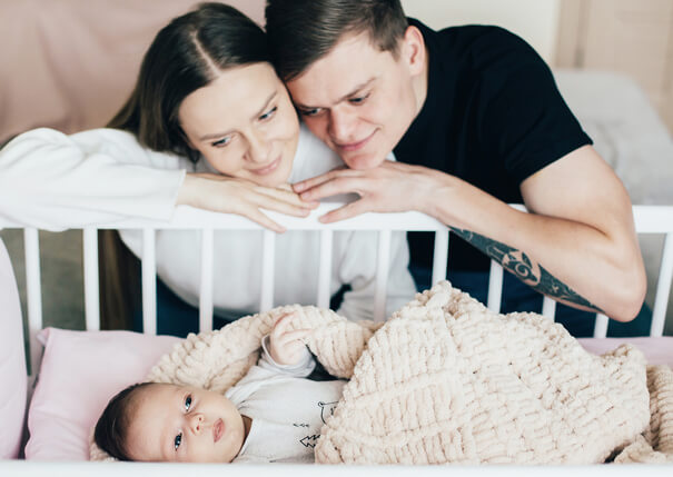 parents-look-baby-crib (1)